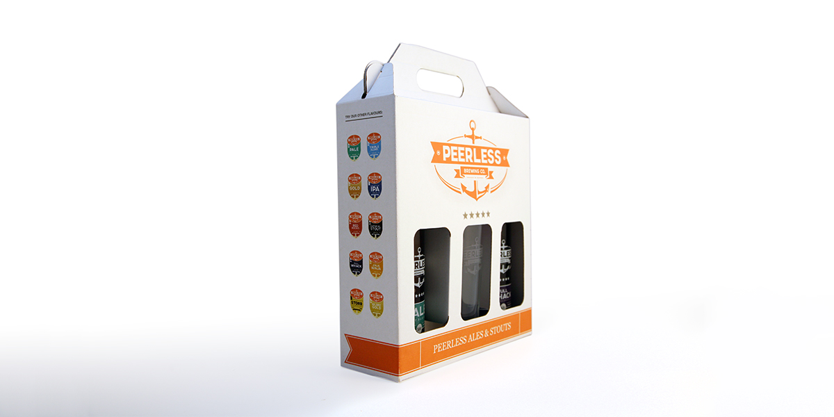 Image of Peerless Brewery branded cardboard cut out box showing 2 Peerless bottles with a branded glass in the middle